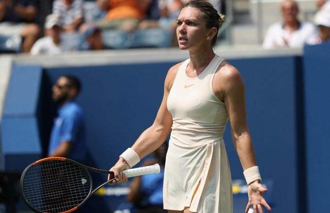 Halep crashes out in US Open