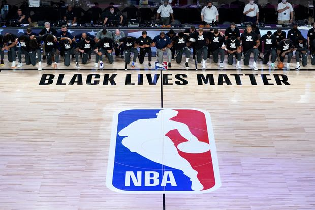 NBA players and coaches take a knee during US national anthem