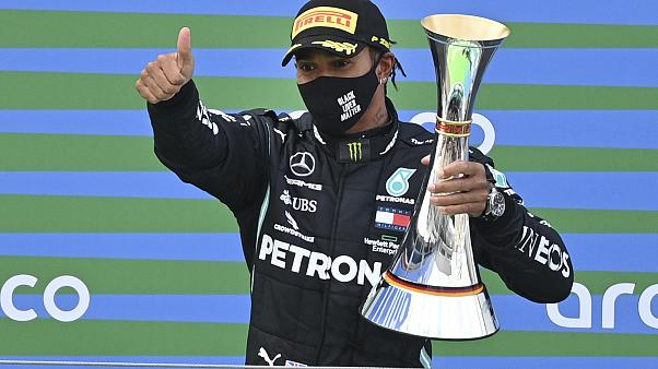 Lewis Hamilton wins Portuguese GP to break Michael Schumacher