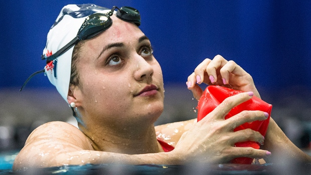 Kylie Masse wins 100m backstroke world gold in record time