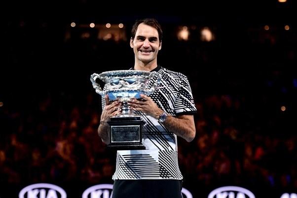 Roger Federer lifts the Australian Open title