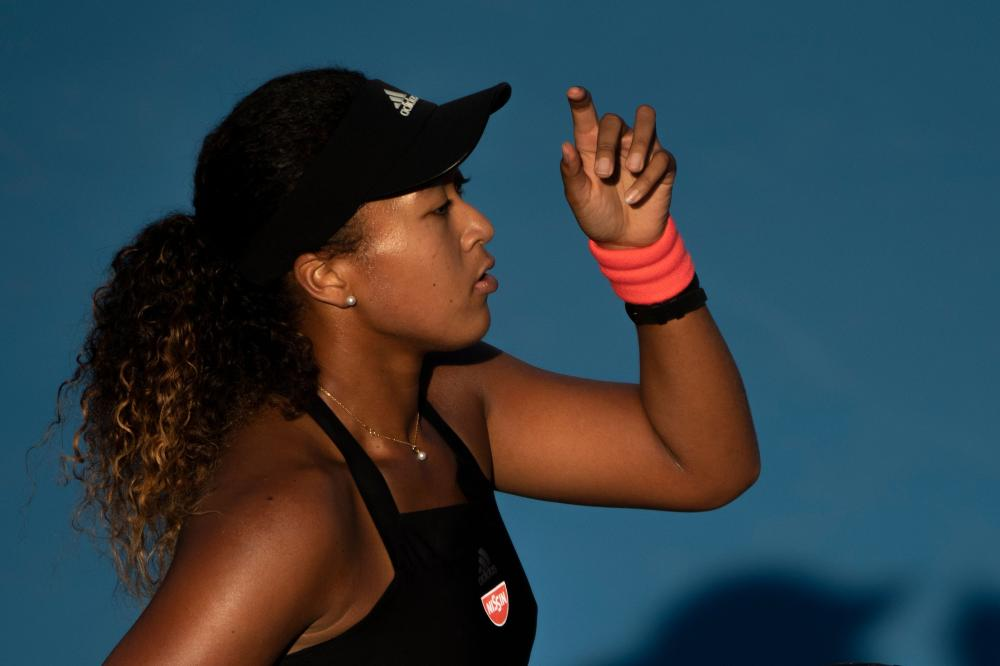 Osaka books WTA Finals berth