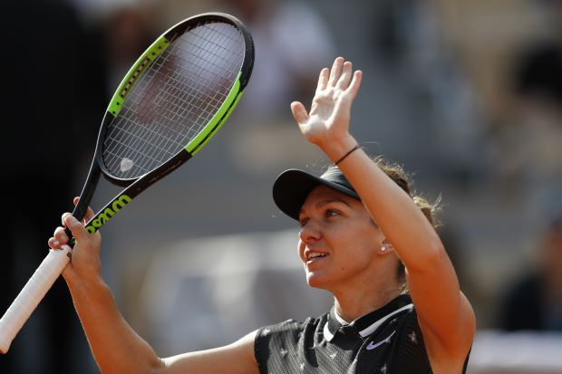 Halep and Djokovic storm into quarter-finals of French Open