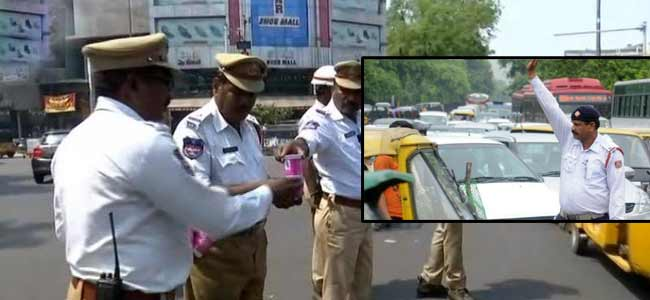 Two traffic police suspended for allegedly illegally recovering money from a cab driver