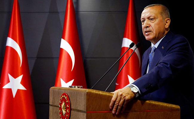 Recep Tayyip Erdogan assumes new presidential powers