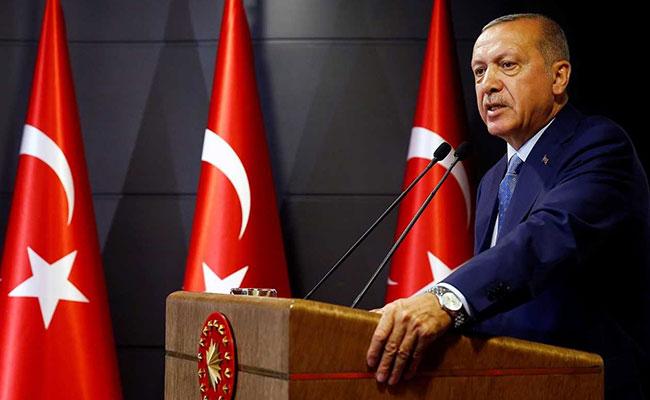 Recep Tayyip Erdogan assumes new presidential powers