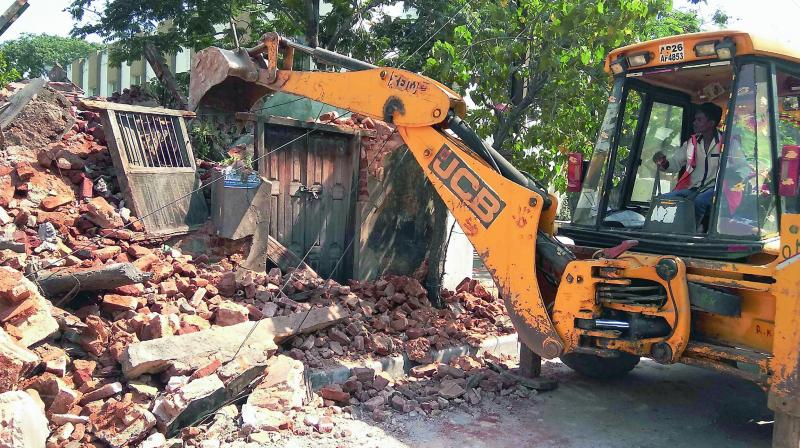 GHMC demolishes unauthorised constructions
