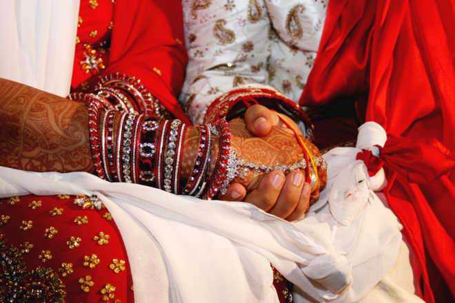 Mass marriages of 21 Sikh couples performed in Hyderabad