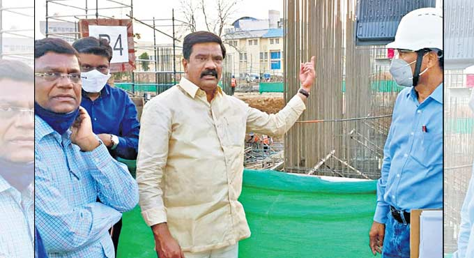 V Prashanth Reddy inspects the construction works of the new Secretariat building