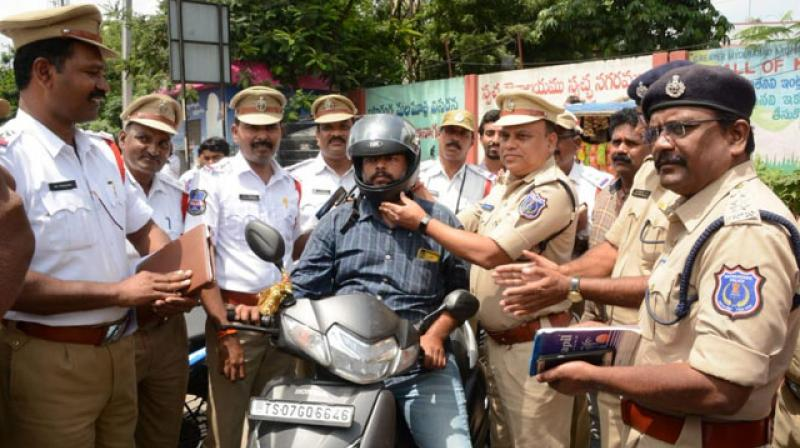 Hyderabad traffic cops award violators with helmets instead of challans