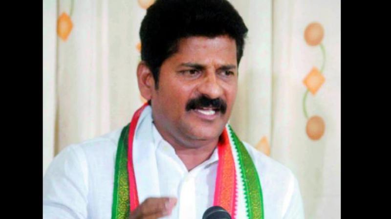Case booked against Revanth Reddy for obstructing cops