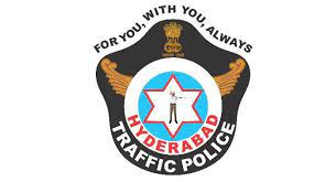 trafficpoliceadvisestwowheelerriderstodrivecarefully