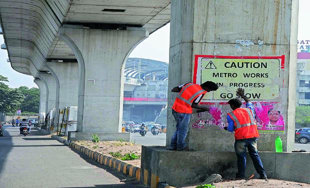 GHMC remove Metro Rail posters