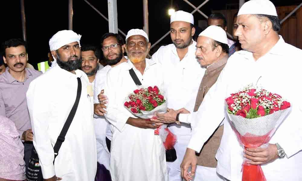 Mohammed Mahmood Ali receives first  batch of Hajis at RGIA airport