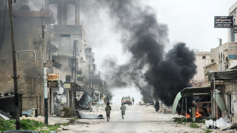 Syrian aid group says 100 people killed, 400 injured in suspected chemical attacks