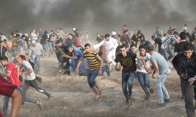 Israeli forces wound 77 Palestinians at protest near Gaza Strip border