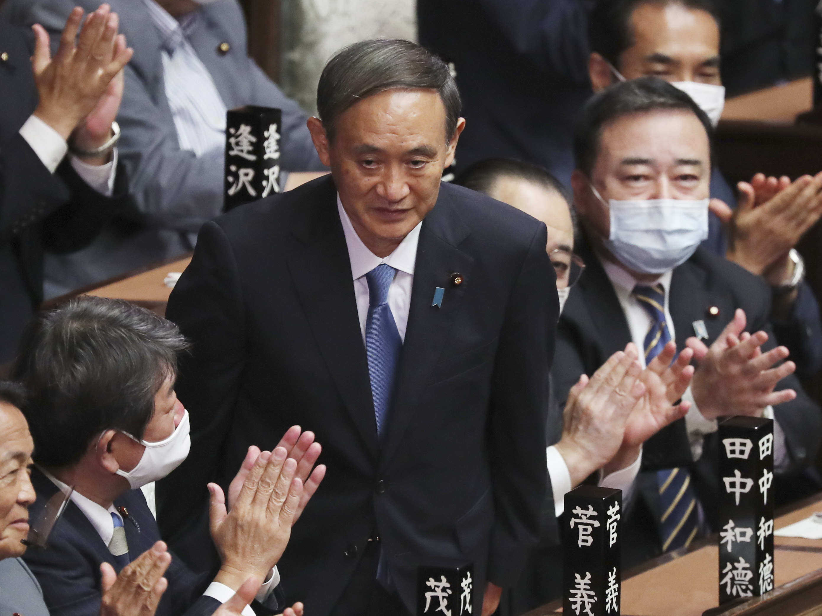 Yoshihide Suga sworn in as Japan