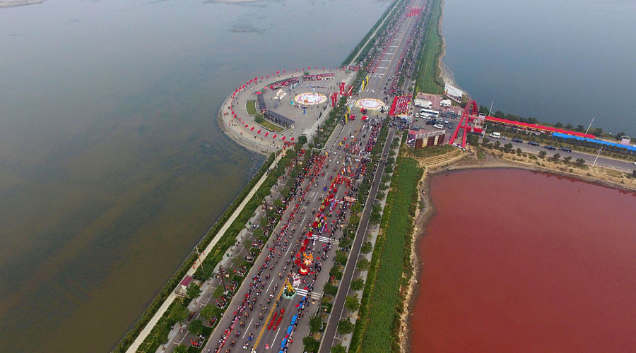 A pink of salt: Ancient lake in China changes colour to pink, attracts tourists