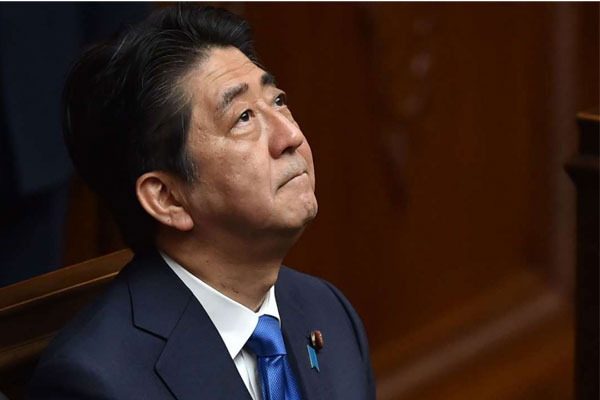 Japan' Abe, headed for longest premiership, seeks balance in cabinet rejig