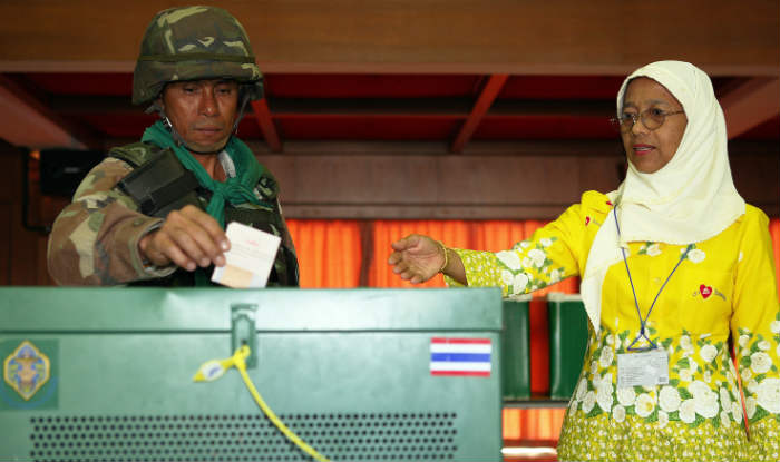 Voters approve a new draft constitution giving extra powers to military in Thailand