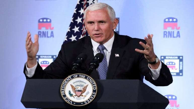 US Vice President Pence visits overcrowded migrant camp, deplores