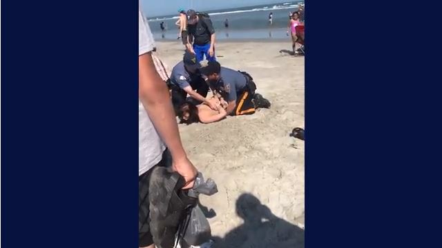 Police filmed punching woman in the head face reassignment