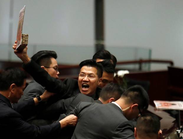 Knife attack on leading activist sparks further chaos in Hong Kong council