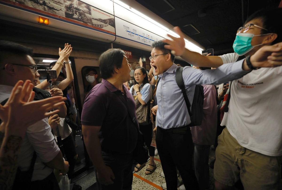 Hong Kong protesters hit subway to disrupt morning commute