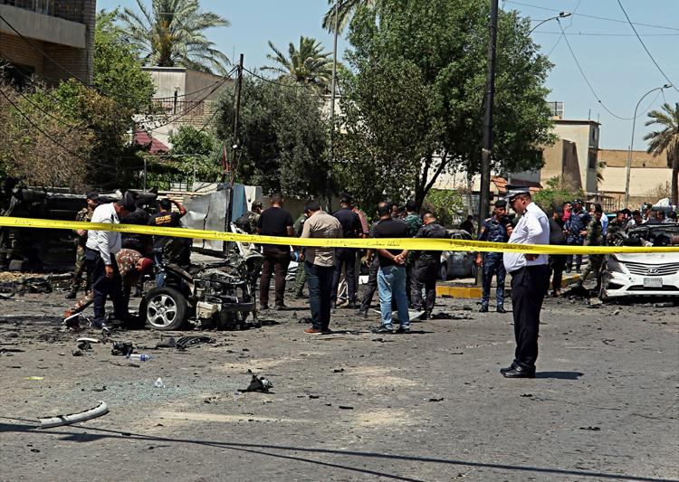 Bomb blast kills 13, hurts 24 in Baghdad; IS claims responsibility