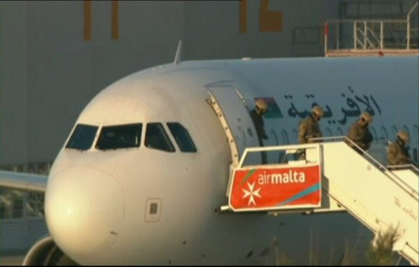 Hijackers surrender after releasing passengers from plane