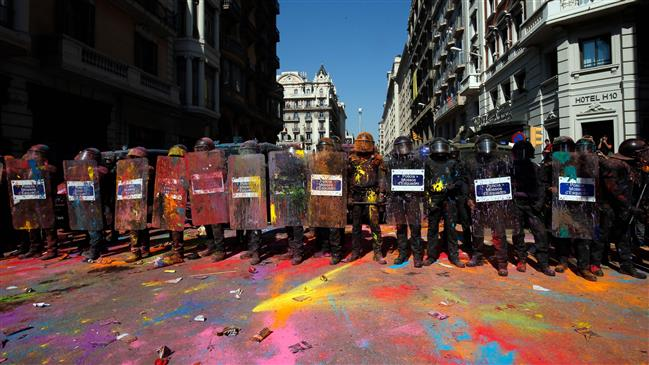Police clash with protesters on day of demos in Barcelona