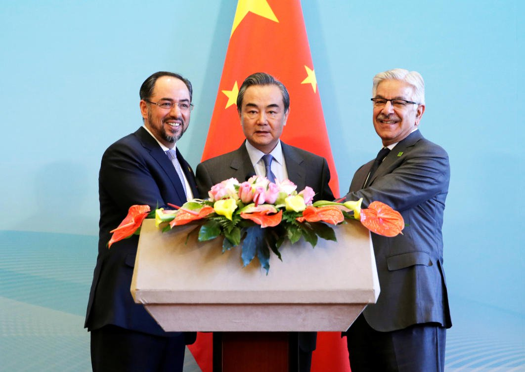China offers to extend CPEC to Afghanistan at first trilateral dialogue