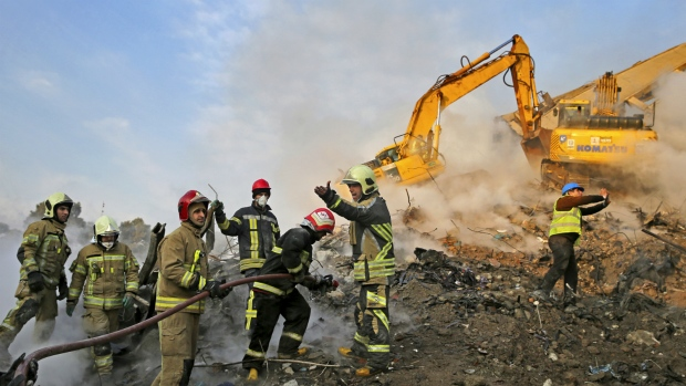 Search crews find 4 more bodies in Tehran building collapse