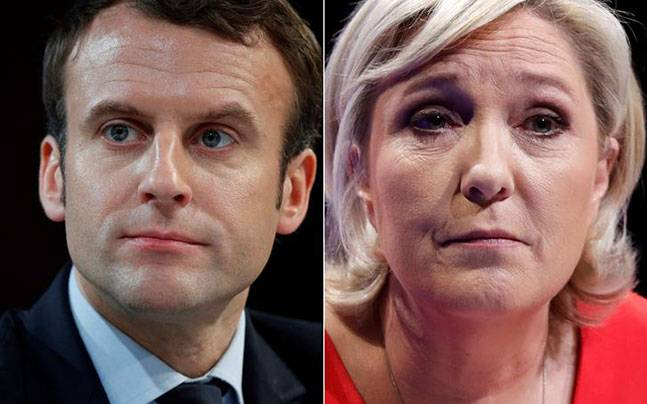 Emmanuel Macron, Marine Le Pen set to face each other in May 7 runoff for French presidency