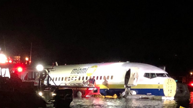 Boeing 737 slides into Florida river with 136 on board