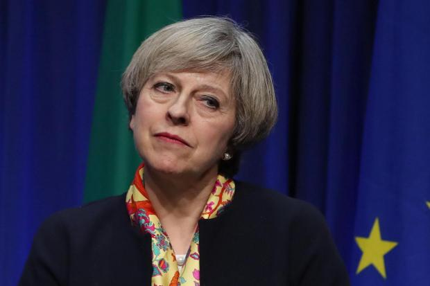 Theresa May under pressure to replace council over London blaze