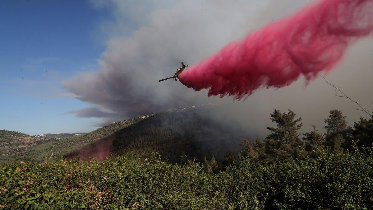 israelifirefightersbattlingmassivewildfirewestofjerusalem