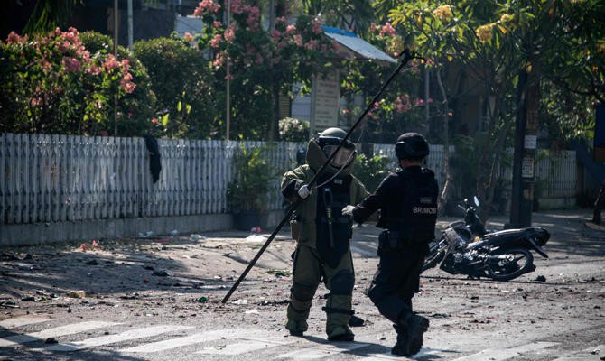 8 dead, nearly 40 wounded as bombs hit 3 Indonesian churches