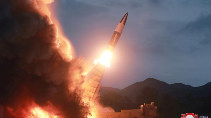 North Korea fires two unidentified projectiles into sea