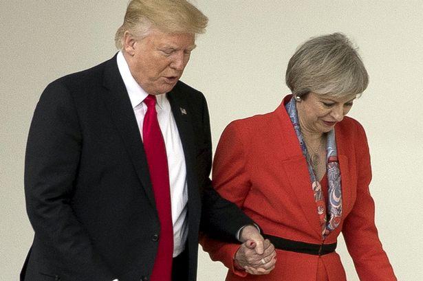 Theresa May backs British envoy in US despite Trump snub