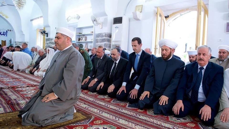 Syrian President Bashar Assad attends holiday prayers at Damascus mosque