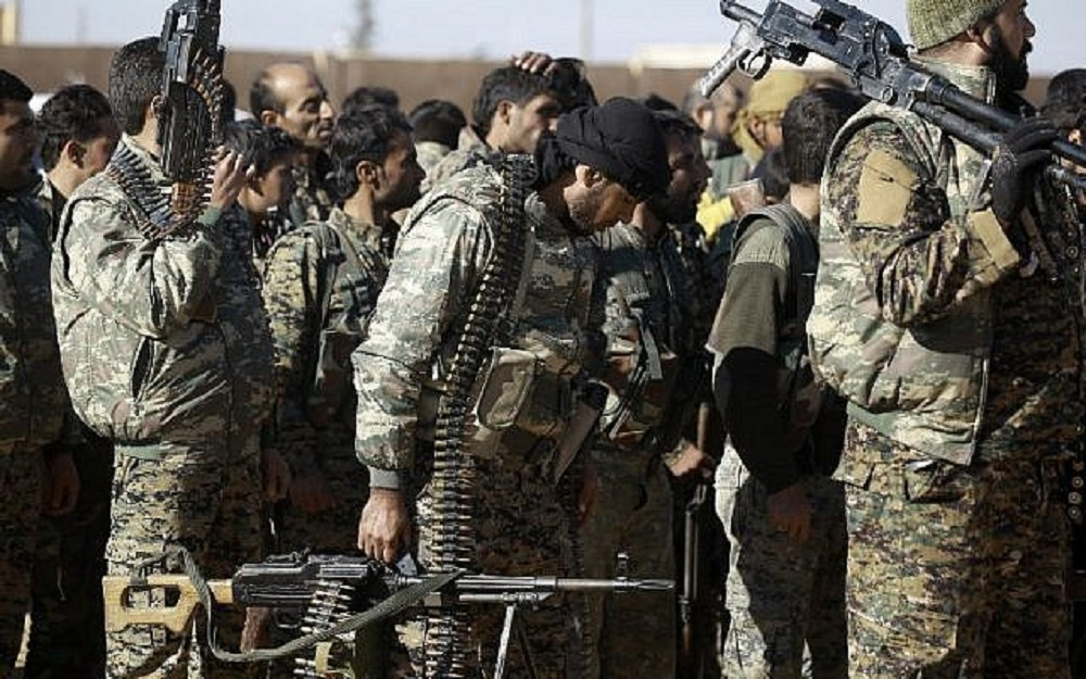 Suicide bomber hits Kurdish-run base in Syria