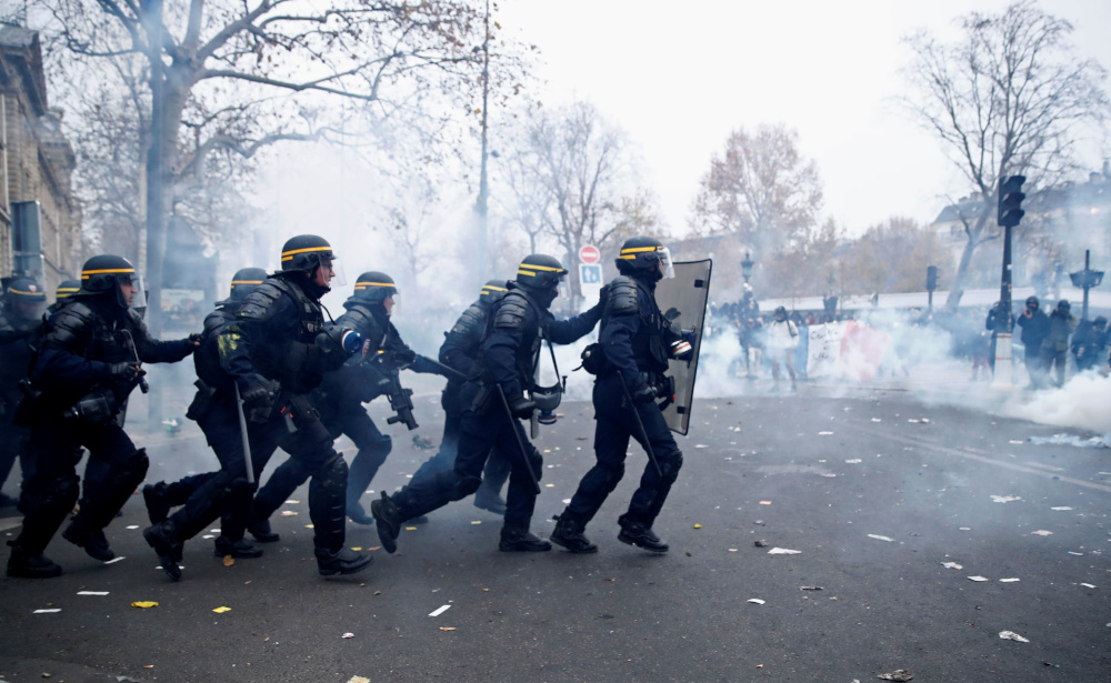 French strike against pension reform enters day two