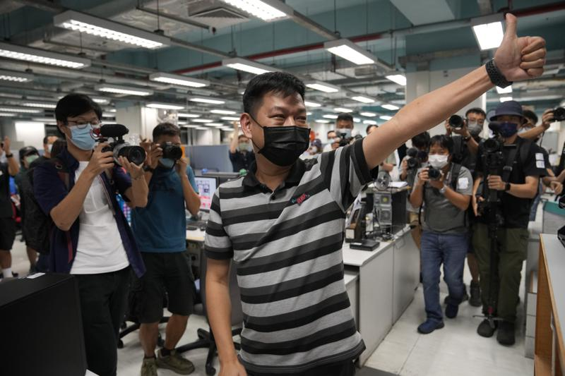 Hong Kong police arrest former Apple Daily editor