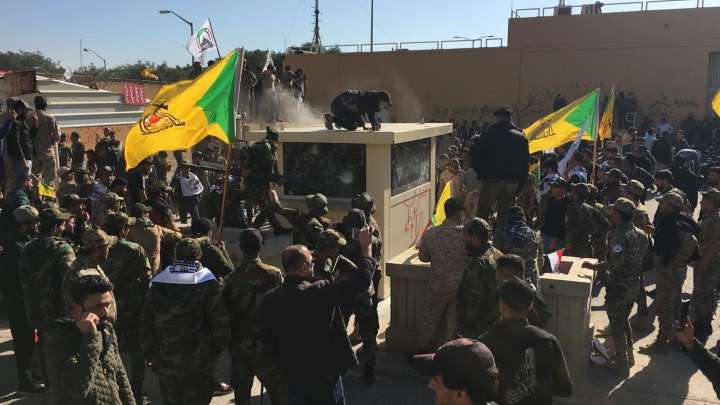iraqprotestersattackusembassyoverstrikes