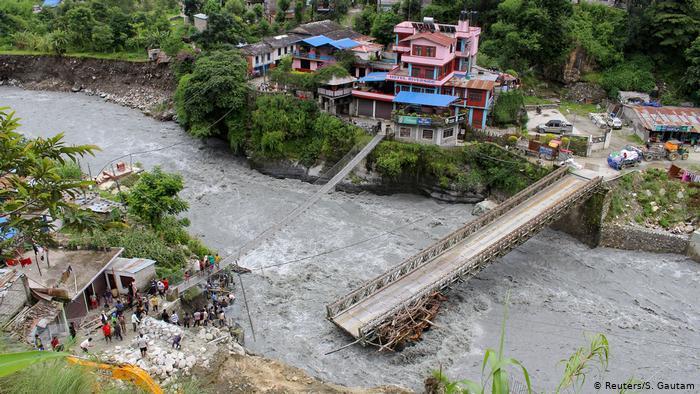 Floods and landslides lash Nepal, scores dead