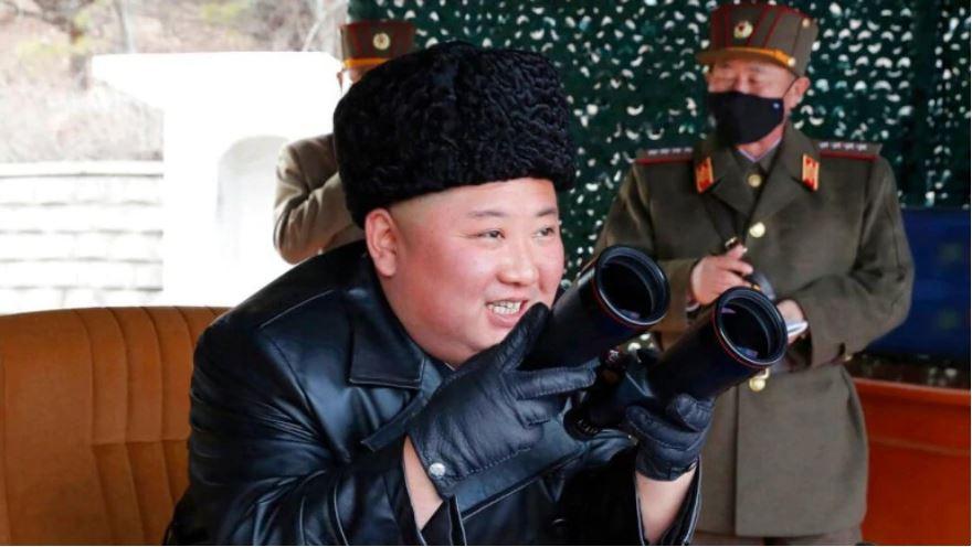 kimjongunwatchesnorthkoreamilitarydrillwithmaskedofficersbyhisside