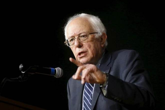 Sanders vows to help Clinton beat Trump