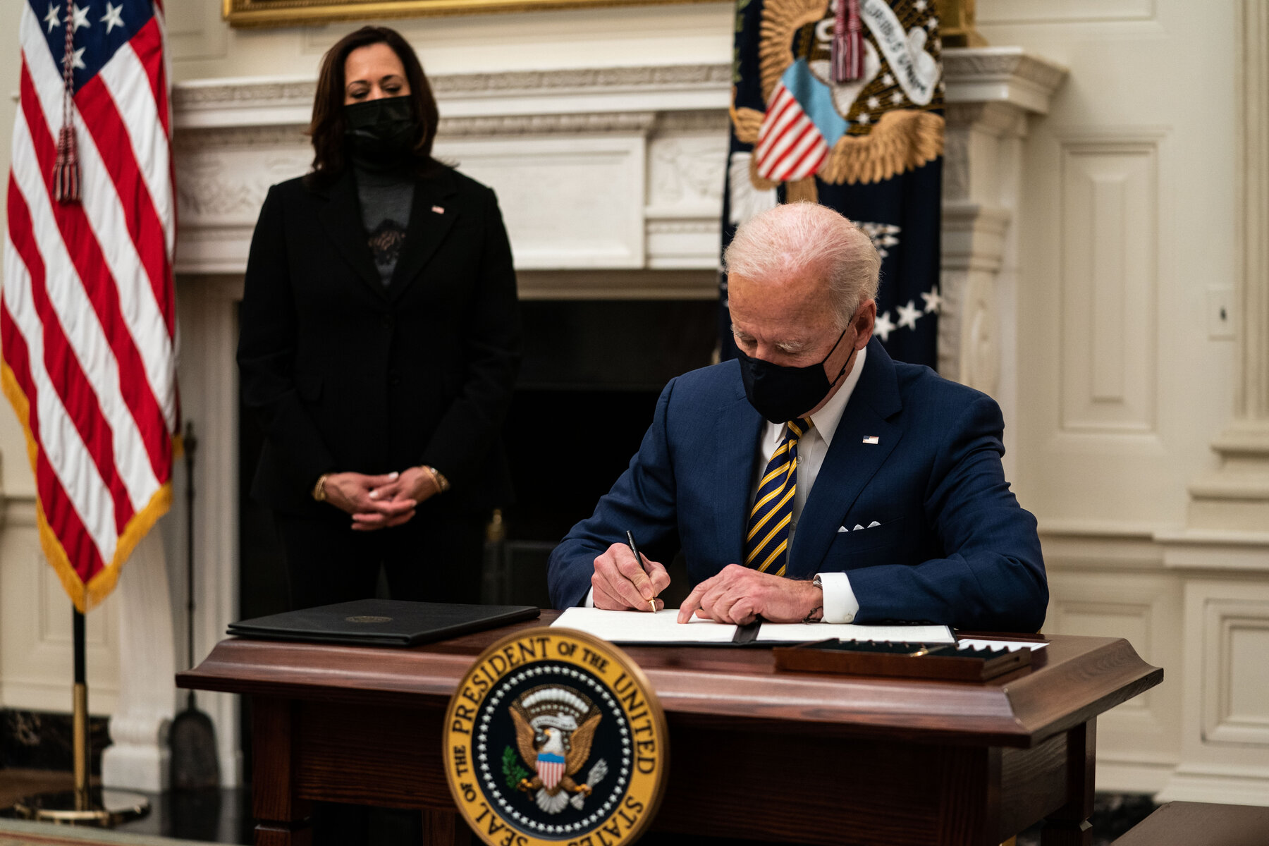 Biden signs executive orders to expand food stamps, up federal pay