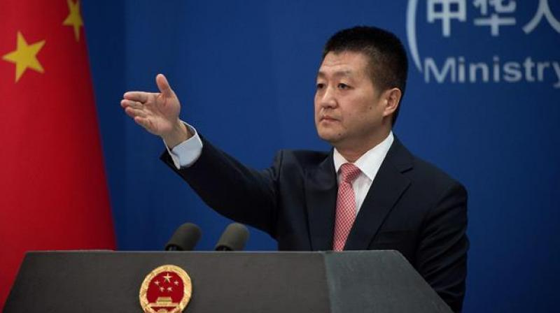 China calls for restraint after India